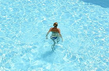 Woman swimming in the Hotel pool, Hotel la Baja, Santa Caterinia di Pittinuri, Sardinia, Italy, Europe