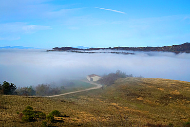 Fog morning in the hills of Umbria, Italy, Europe