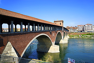 The historic and ancient covered bridge over the Ticino river, Pavia, Lombardy, Itay, Europe