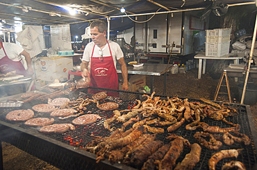 """Sartizzu arrustiu"" rost Sausage, ""Cordula"" made up of braided and cooked kid or lamb intestines wrapped around a spit, typical Sardinia recipe, Campidano, Sardinia, Italy, Europe"
