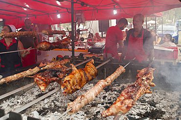"""Porceddu"", roast baby pork wrapped around a spit, ""Cordula"" made up of braided and cooked kid or lamb intestines wrapped around a spit, typical Sardinia recipe, Campidano, Sardinia, Italy, Europe"