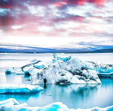 Jokulsarlon lake with icebergs at night, Iceland. Long exposure view at sunset