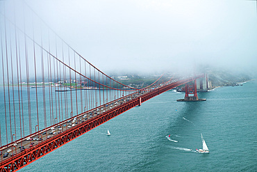 Golden Gate Bridge surrounded by fog, San Francisco.