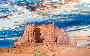 Panoramic view of Monument Valley mountain and road across national park.