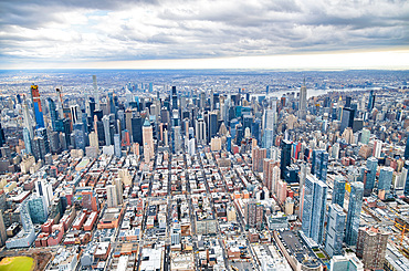 New York City from helicopter point of view. Midtown Manhattan skyscrapers on a cloudy day, USA