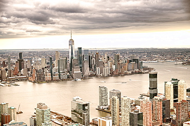 New York City from helicopter point of view. Downtown Manhattan, Jersey City and Hudson River on a cloudy day.