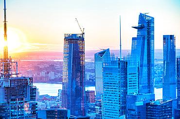 Manhattan skyline at dusk, aerial view of New York buildings.