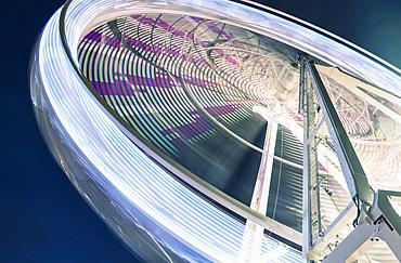 Spinning panoramic wheel. View at night.