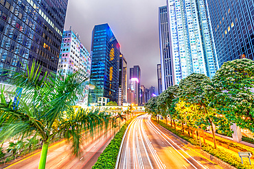 Hong Kong buildings and traffic. City skyline at night. Business concept.