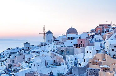 Sunset landscape and cityscape of Oia in Santorini Island, Greece.