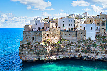 Polignano a Mare - Apulia, Italy. Beautiful aerial view of cityscape and coastline on a beautiful summer day.