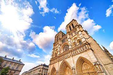 Notre Dame majestic facade against a beautiful blue sky, Paris