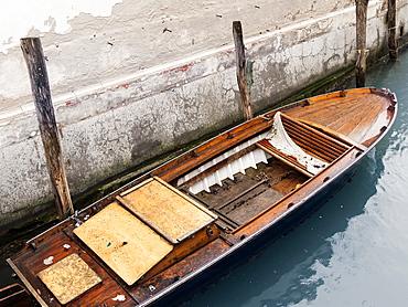 A small boat moored along the canal near the Hotel Ca Maria Adele, Venice, Veneto, Italy, Europe