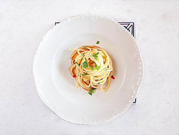 Spaghetti pasta with anchovy sauce, Colatura, parsley and fresh chilli. Cetara, Amalfi Coast, Campania, Italy; Europe