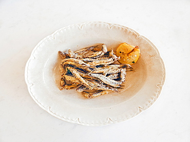 Fried anchovies in an old English porcelain plate, Cetara, Amalfi Coast, Campania, Italy, Europe