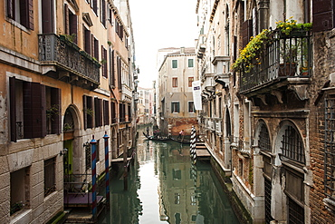 A view over the canal, In the distance you can see two gondolas, a typical boat used in Venice to wade channels led by a sailor, Veneto, Italy, Europe