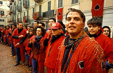 """Asso di Picche"" squad after the battle, Traditional carnival, Ivrea, Piemonte, Italy"