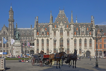 An open carraige awaits passengers on the Market Square in front of the Provincial Court Building, Brugge, UNESCO World Heritage Site, Belgium, Europe