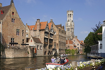 Canal view with a tour launch, Flemish gables and the Belfry tower, Brugge, UNESCO World Heritage Site, Belgium, Europe