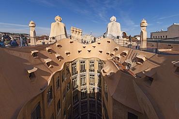 Upper floor and roof chimneys of the apartment building designed by Antonio Gaudi, La Pedrera (Casa Mila), UNESCO World Heritage Site, Passeig de Gracia, Barcelona, Catalonya, Spain