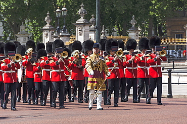 Guards Military Band marching past Buckingham Palace en route to the Trooping of the Colour, London, England, United Kingdom, Europe