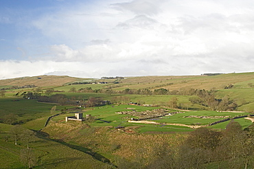 Looking west over Roman settlement and fort, Vindolanda, with the Roman Wall on the skyline, UNESCO World Heritage Site, Northumbria, England, United Kingdom, Europe
