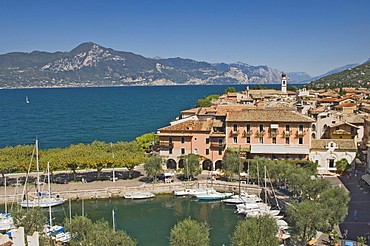 View from the castle ramparts of the harbour and town of Torre del Benaco (Torri del Benaco), Lake Garda, Veneto, Italian Lakes, Italy, Europe