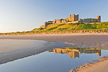 Morning light on the beach at Bamburgh Castle, Northumberland, England, United Kingdom, Europe