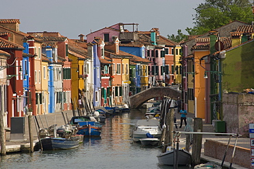 Pastel coloured houses alongside a canal in Burano, Venetian Lagoon, Venice, Veneto, Italy, Europe