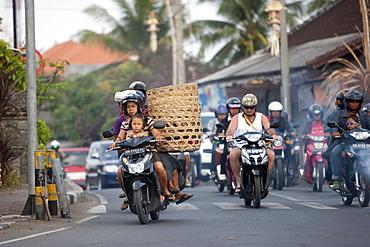 Motor cycles in traffic, Kuta, Bali, Indonesia, Southeast Asia, Asia
