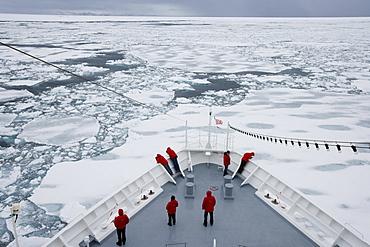 Ship breaking through ice floe and drift ice, Greenland, Arctic, Polar Regions