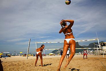 Women playing volleyball on Ipanema beach, Rio de Janeiro, Brazil, South America