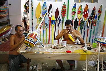 Artist at a local workshop making wooden boats as souvenirs, Paraty (Parati), Rio de Janeiro State, Brazil, South America