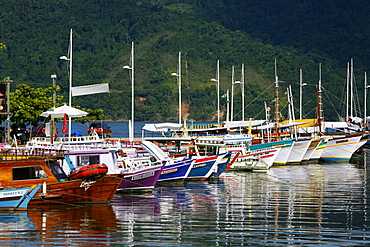 Colorful fishing boats in the harbour, Paraty (Parati), Rio de Janeiro State, Brazil, South America