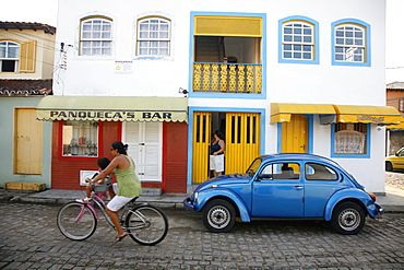 People riding a bicycle, Paraty (Parati), Rio de Janeiro State, Brazil, South America
