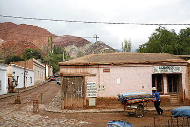 Street scene in Purmamarca with the Mountain of Seven Colors in the background, Purmamarca, Quebrada de Humahuaca, UNESCO World Heritage Site, Jujuy Province, Argentina, South America