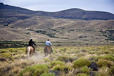 Gauchos riding horses, Patagonia, Argentina, South America