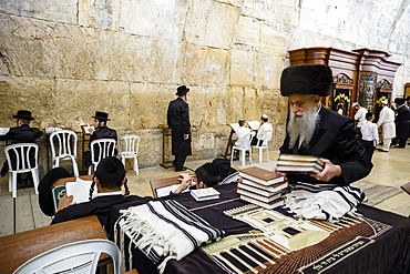 Orthodox Jewish people praying at a synagogue by the Western Wall (Wailing Wall) in the Old City, Jerusalem, Israel, Middle East