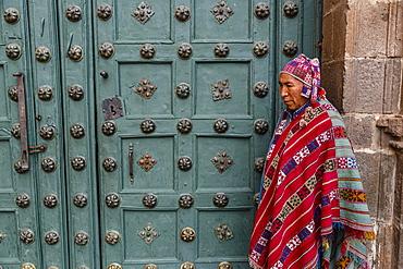 The entrance door to Capilla de San Ignacio de Loyola on Plaza de Armas, Cuzco, Peru, South America