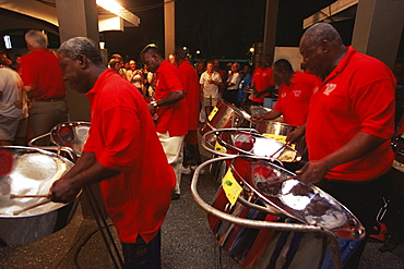 Steel pan band playing at the Sunday School, a street party held in Buccoo, Tobago, West Indies, Caribbean, Central America