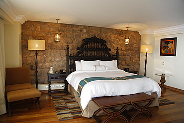 Monastery wall at a room in the Marriott Hotel, Cuzco, Peru, South America