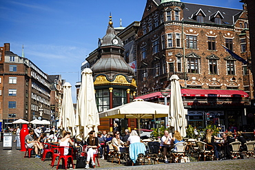 People sitting at a cafe in Nytorv, Copenhagen, Denmark, Scandinavia, Europe