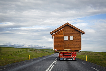 Wooden house being transported on a truck, South Iceland, Iceland, Polar Regions