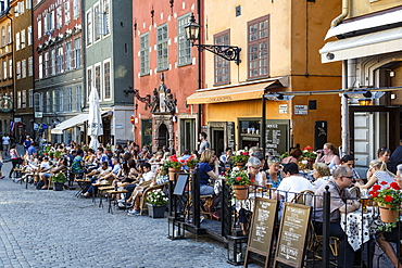 People sitting at a restaurant in Stortorget square in Gamla Stan, Stockholm, Sweden, Scandinavia, Europe