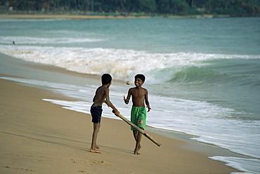 Boys playing cricket, Hikkaduwa beach, Sri Lanka, Asia