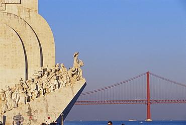 Padrao dos Descobrimentos (Monument of the Discoveries) and Ponte 25 de Abil (25th April) bridge, over the River Tagus, Lisbon, Portugal, Europe