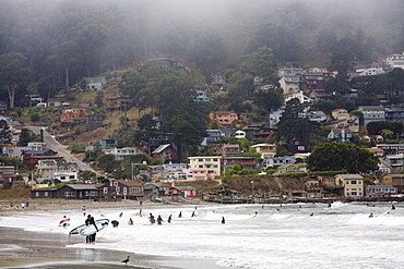 Surfers at Linda Mar beach, Pacifica, California, United States of America, North America