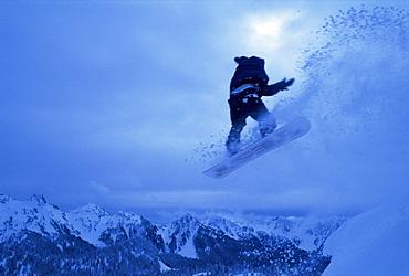 Snowboarder heads down, Paradise area, Mount Rainier, Washington State, United States of America (U.S.A.), North America