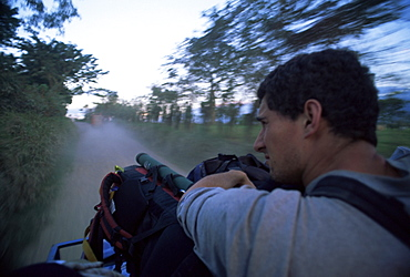 Adventure travel, the road to Rio Dulce from the back of a truck, Guatemala, Central America