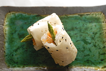 Sushi appetizer of salmon and asparagas in rice and sesame parcel, Japan, Asia